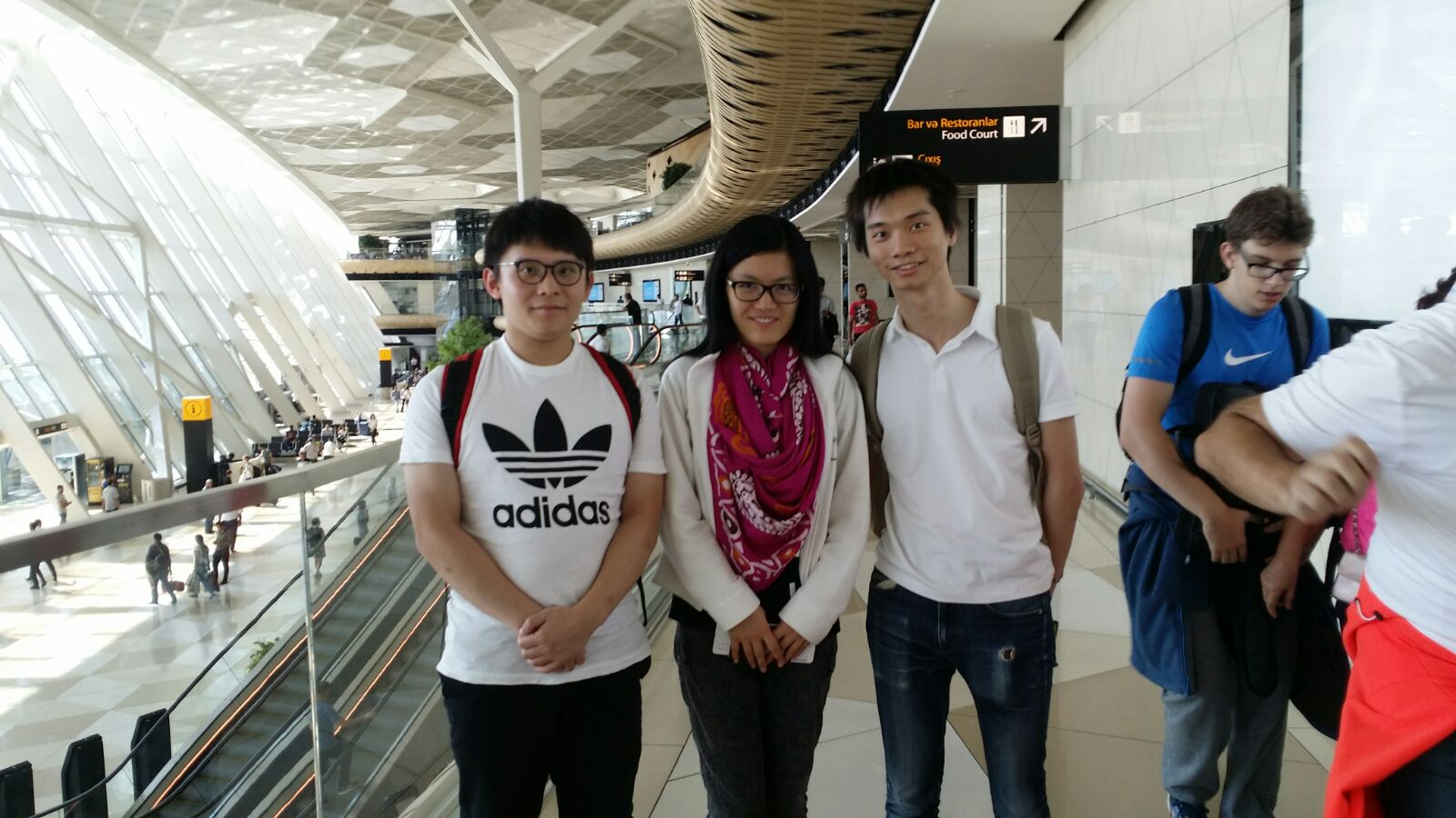 CM Pang Yui Kuen, World Woman Champion Hou Yi Fan, FM Brian Wong (left to right)